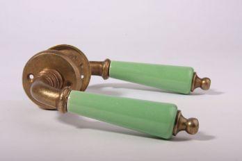 Deurklinken (paar) met rozetten brons antiek met groen porselein