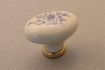 Wit porseleinen knop 34mm ovaal met blauwe bloem messing polijst