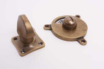vrij-bezet wc-sluiting tonmodel brons antiek met zwart/wit plaatje