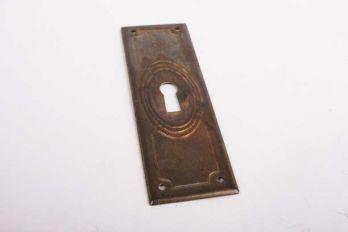 Sleutelplaat verticaal voor kastdeur dun brons antiek 32 mm