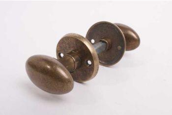 Deurknoppen voor binnendeuren in brons antiek met ronde krukrozetten per paar